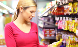 consumer reading a label