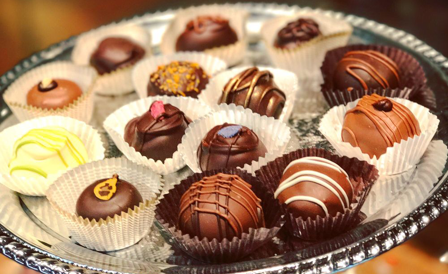 Award-winning chocolates are served on a silver platter.