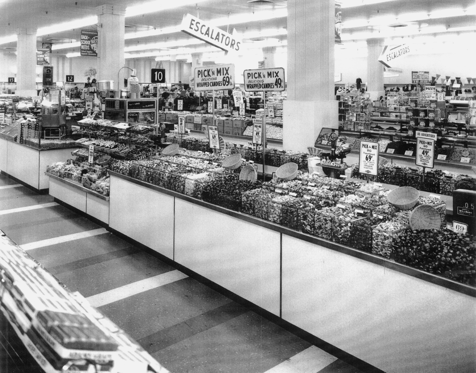 The F W Woolworth Co Picked Up The Idea Of Customer Mixed Bulk Candy For Its Chain Of Five And Dime Stores At The Candy Department Of This Woolworth In